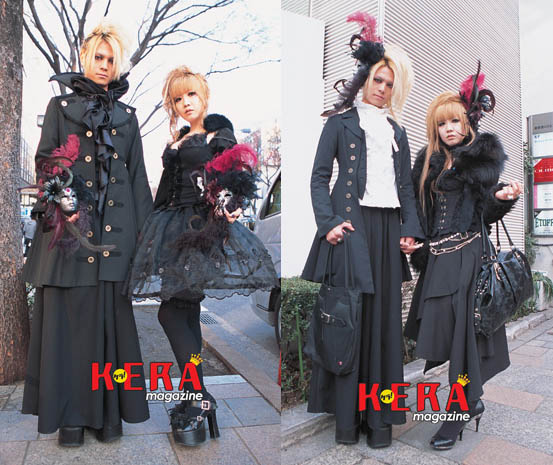 Gothic Lolita street style snaps from Japan. Goth designer couple in military jackets, masks.