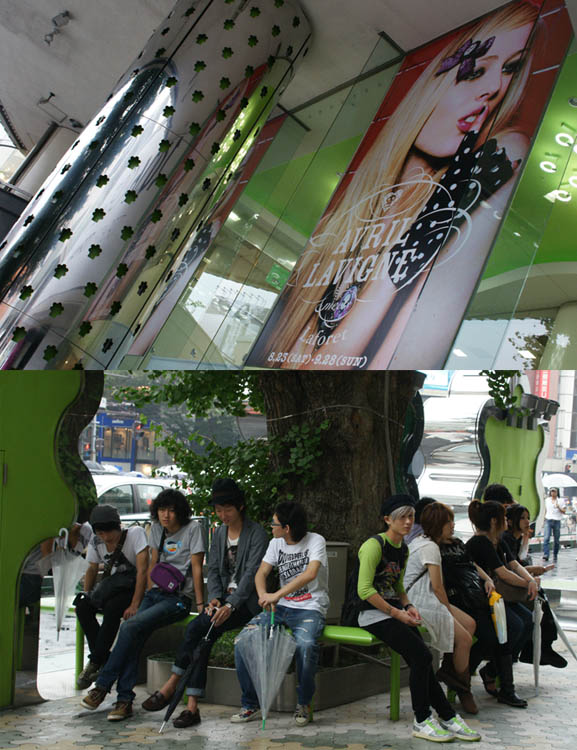 Laforet department store in Harajuku with Avril Lavigne special collaboration. Big pop singer poster and fashionable teens outside Tokyo shopping center.