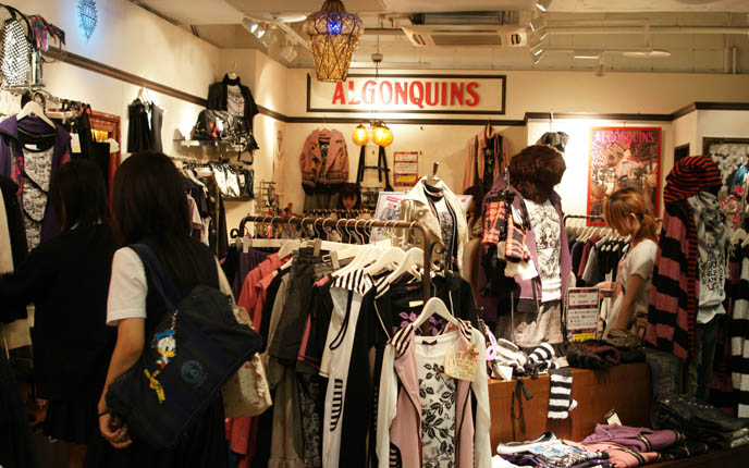 Algonquins punk t-shirts, black and white striped scarves, pink shirts, Hot Topic store interior. Japanese goth punk brand at Laforet Harajuku.