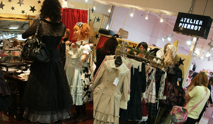 Atelier Pierrot gothic and sweet lolita store in Laforet, with brands Victorian Maiden, Innocent World, Beth, little hats and lace accessories. Tall male gosurori, tranny lolita.