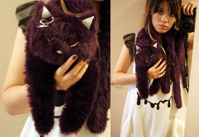 Cute cat scarf from Japan, purple furry scarf with animal head, Hello Kitty character. Weird and crazy scarf from Tokyo.