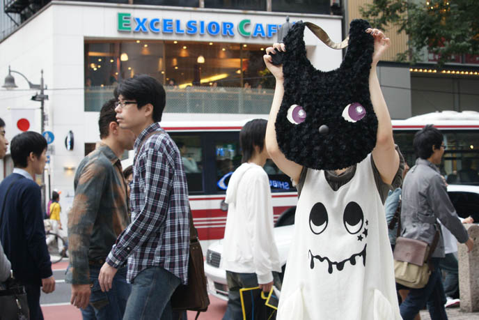 Excelsior Caffe in Shibuya, Tokyo Japan. Coffee shop with soy lattes. Bunny as head, purse on girl with funny cute Japanese street fashion dress.