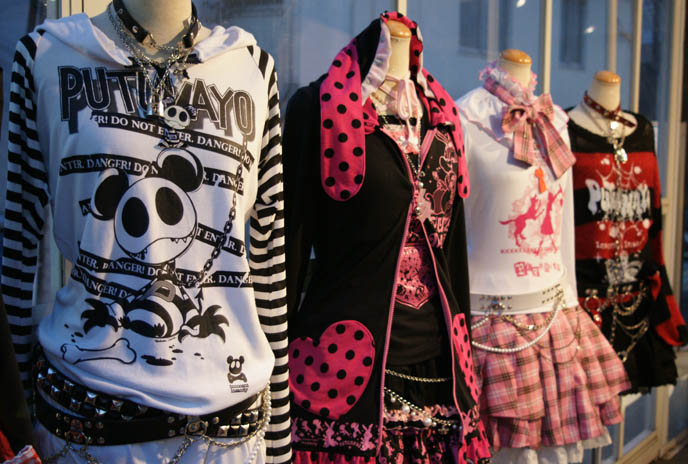 Emo clothing, fashion. Plaid puff skirts. Putumayo Japanese gothic and punk lolita brand. Shopping and store photos in Harajuku Tokyo. Emo striped t-shirts, signs and storefront.