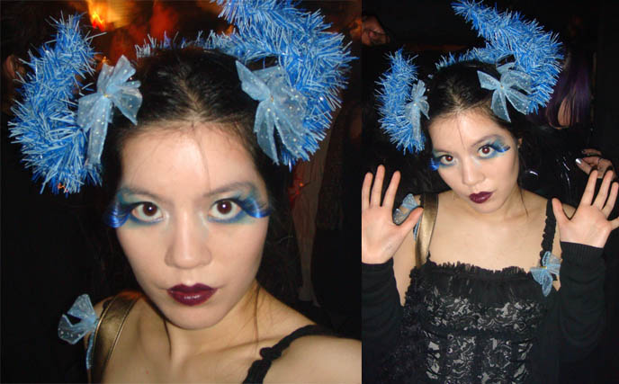 Cyber gothic club outfit at Tokyo Dark Castle. La Carmina in blue Anna Sui fake eyelashes, dark purple MAC lipstick, bows and horns on head from Daiso Japan dollar store.