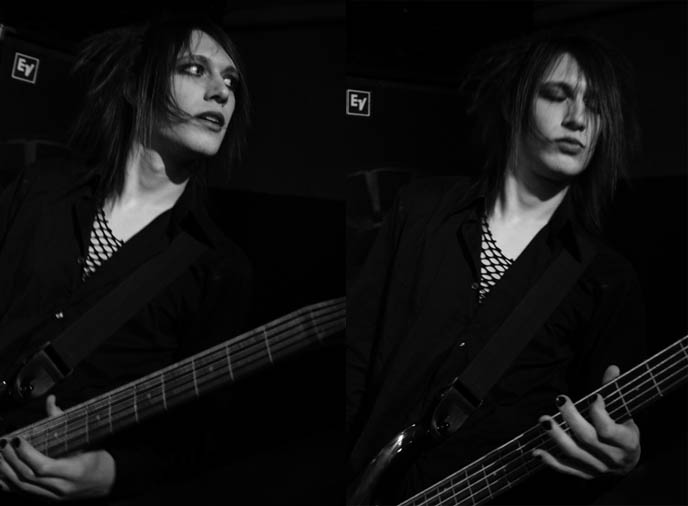 Classic black and white 1970s rockstar concert photography, glam rock androgyny musician, long emo hair and eye makeup on boy.